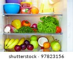 refrigerator full of healthy food. fruits and vegetables - stock photo