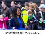 LIMERICK, IRELAND - MARCH 17: Unidentified girl participates in a parade for St. Patrick's Day. It's a traditional Irish holiday celebration. March 17, 2012 in Limerick, Ireland. - stock photo