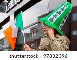 LIMERICK, IRELAND - MARCH 17: Unidentified child with an Irish hat participates in a parade for St. Patrick's Day,  traditional Irish holiday. March 17, 2012 in Limerick, Ireland. - stock photo