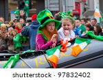 LIMERICK, IRELAND - MARCH 17:Unidentified children with Irish hat  participate in a parade for St. Patrick's Day. It's a traditional Irish holiday celebration. March 17, 2012 in Limerick, Ireland. - stock photo