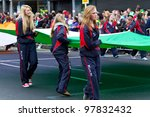 LIMERICK, IRELAND - MARCH 17: Unidentified schoolgirls with Irish flag participate in a parade for St. Patrick's Day. It's a traditional Irish holiday celebration. March 17, 2012 in Limerick, Ireland. - stock photo