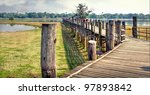 landscape in asia with a wooden bridge crossing the river - stock photo