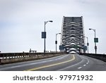"""""""Roadway and Bayonne Bridge"""" A roadway view of the Bayonne Arch Bridge, connecting Bayonne, NJ to Staten Island New York. It's is the third largest arch bridge in the world. - stock photo"""