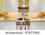 Stock photo narrow white and yellow kitchen with cabinets close up 97977965
