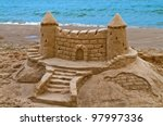 sand castle on the beach of... | Shutterstock . vector #97997336
