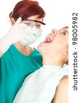young woman on dental visit, white background - stock photo