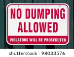 no dumping sign on a metal wall. | Shutterstock . vector #98033576