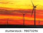 Wind turbines field at sunset - stock photo