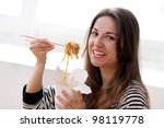 happy woman eating noodles at... | Shutterstock . vector #98119778