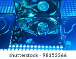harddisk isolated on with fiber optical background - stock photo