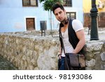 Portrait of young attractive man in urban background - stock photo