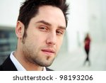 Close up portrait of a handsome young business man - stock photo