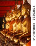 row of sitting buddha statues...