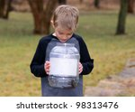 Small photo of Boy with critters in a cage, Smallmouth Salamander, Ambystoma texanum - learning about nature