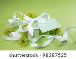 gift box with flowers on green...   Shutterstock . vector #98387525