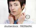 portrait of young woman in medical gown - stock photo
