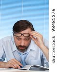 a businessman is considering a... | Shutterstock . vector #98485376