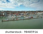 shot of  cowes harbour on the isle of white from aboard a ship coming into east cowes - stock photo