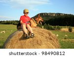 Teenage boy playing with the dog (Alsatian) on the meadow - summer in the country by sunset. Happiness, emotion. - stock photo