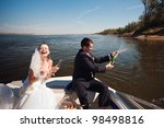bride and groom with champagne... | Shutterstock . vector #98498816