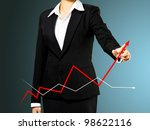 Business woman and growth graph - stock photo