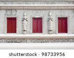 Three native windows and sculpture on the wall of temple in chiangmai Thailand. - stock photo
