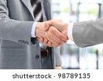 business men in a handshake at... | Shutterstock . vector #98789135