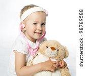 little girl plays doctor | Shutterstock . vector #98789588