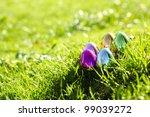 shiny easter eggs in grass | Shutterstock . vector #99039272