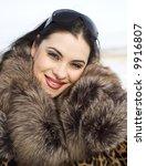beauty woman in leopard fur coat - stock photo