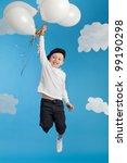 playful boy flying on balloons | Shutterstock . vector #99190298