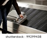 business man picking up metal... | Shutterstock . vector #99299438