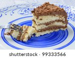 Gateau Au Chocolat - Chilled homemade Victoria sponge cake with chocolate buttercream filling on a hand painted blue and white plate. - stock photo