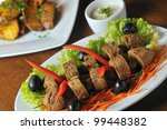 deep fried beef testicles with... | Shutterstock . vector #99448382