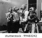 kids biting apples on strings... | Shutterstock . vector #99483242