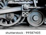 Steam locomotive wheels and rods closeup - stock photo