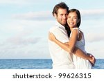 happy young couple on beach in... | Shutterstock . vector #99626315