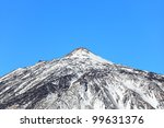 Mountain top of Volcano Teide, Tenerife. Snow covered in winter. Pico del Teide, Tenerife, Canary Islands, Spain. - stock photo