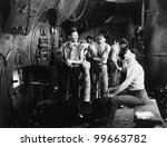 Men together in a ship's boiler room - stock photo