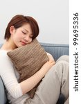 young woman sleeps on a bed in... | Shutterstock . vector #99695336