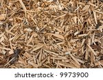 monochromatic background of wooden and bark chips mulch - stock photo