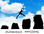 Silhouette of a successful businessman jumping off obstacles to reach the top of his carrier. - stock photo