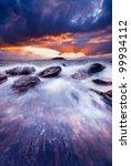 Gorgeous sunset over crashing waves - stock photo