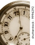 100 Year old antique pocket watch in Sepia Color - stock photo