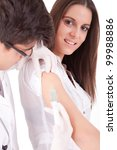 Doctor giving vaccine to a young woman - stock photo