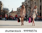 Two Young Women With Shopping...