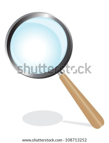 magnifying glass on a wooden
