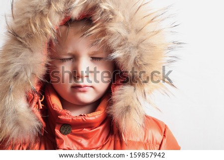 child in fur hood and orange