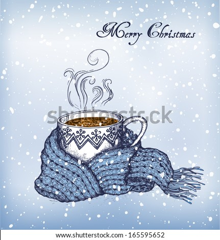 cup of tea swathed in scarf