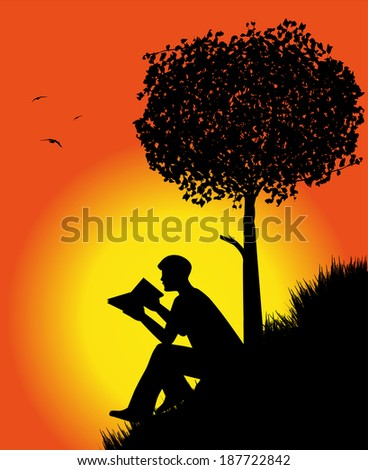 man silhouette reading a book